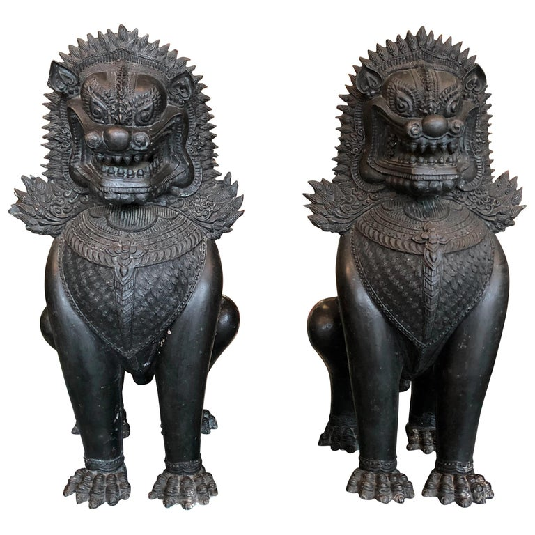 Antique Pair of Bronze Standing Foo Dogs Khmer Style For Sale