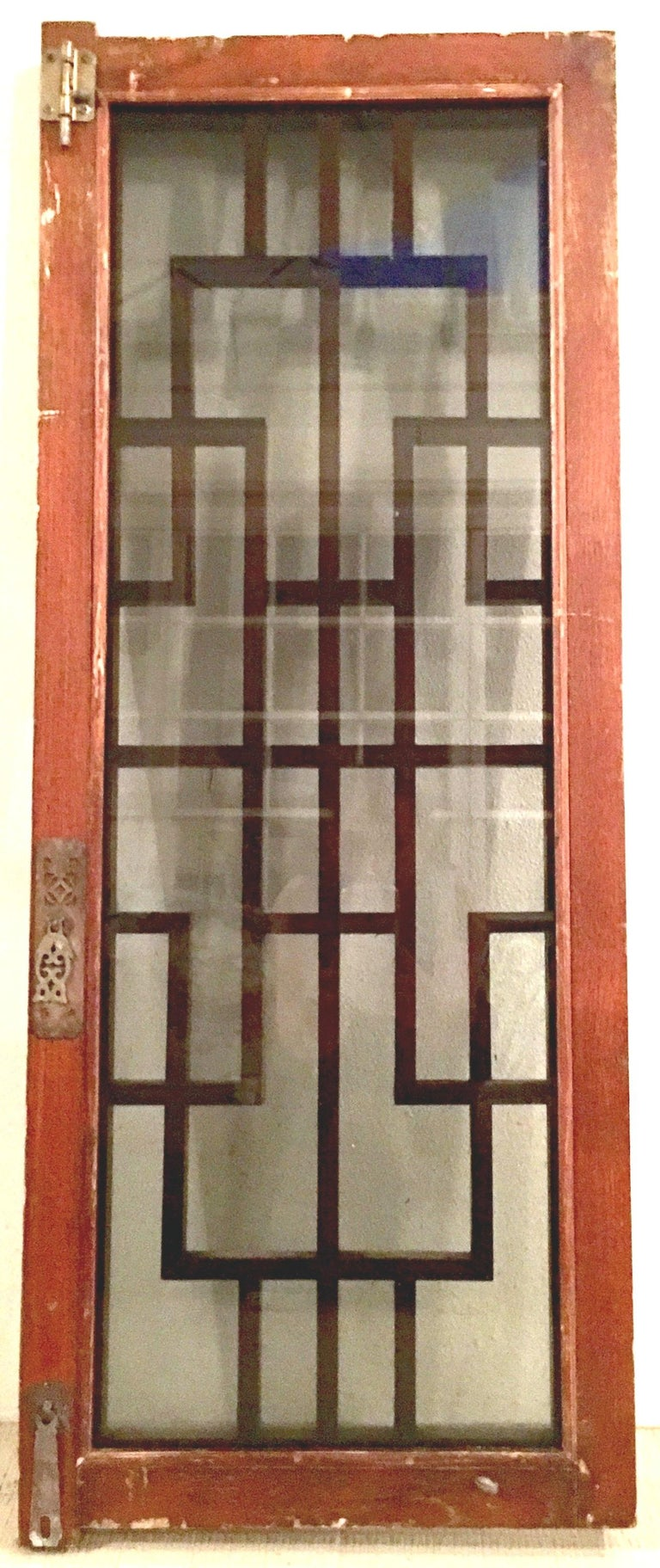 Brass Antique Pair Of Chinese Carved Mahogany and Smoke Glass Windows For Sale