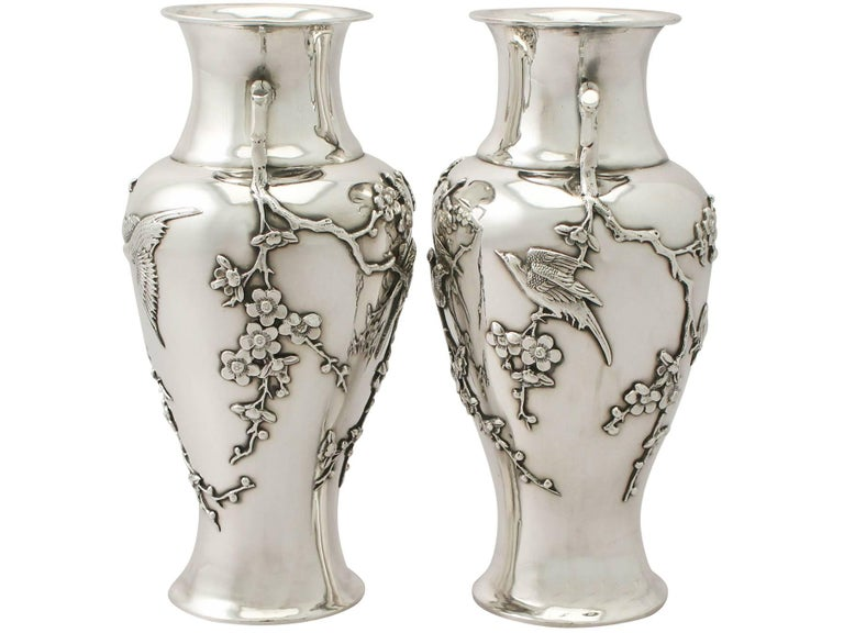 A fine and impressive pair of antique Chinese Export silver vases; an addition to our ornamental silverware collection.