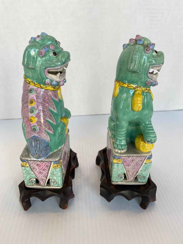 Chinese Export Antique Pair of Chinese Porcelain Famille Rose Foo Dogs For Sale