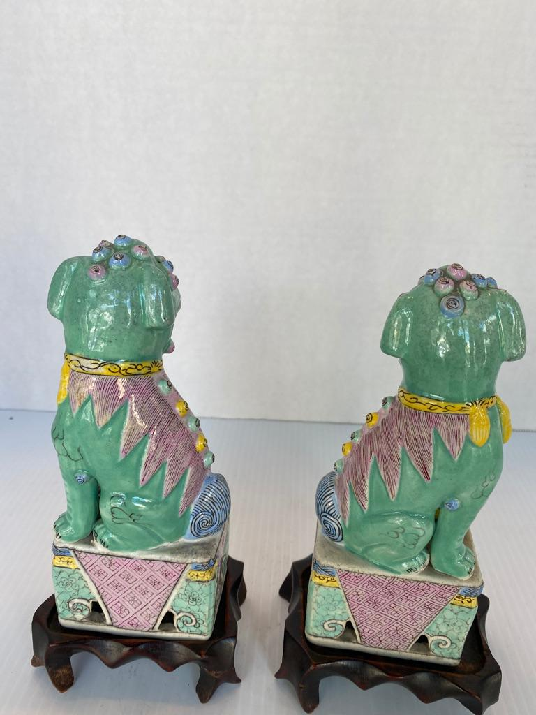 Antique Pair of Chinese Porcelain Famille Rose Foo Dogs In Good Condition For Sale In Sarasota, FL