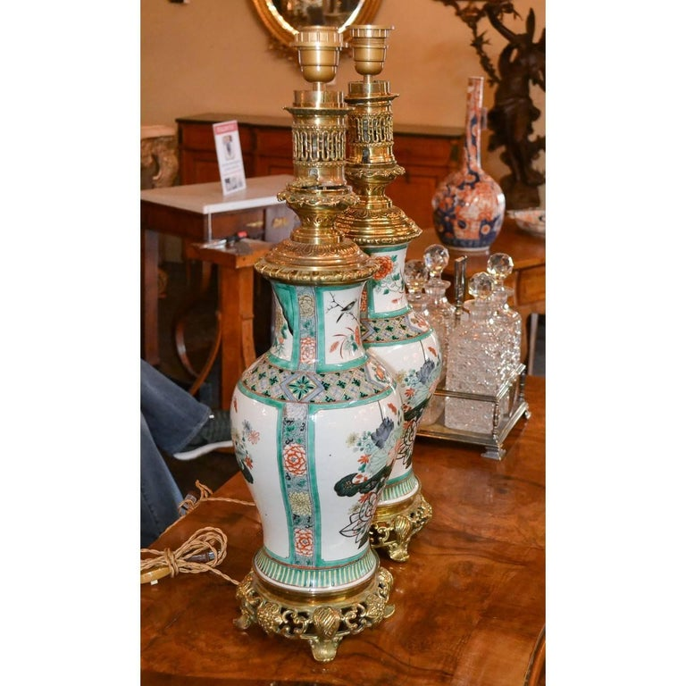 Amazing pair of Chinese porcelain rose medallion table lamps, circa 1880. Measures: 24 inches height x 7.5 inches wide.