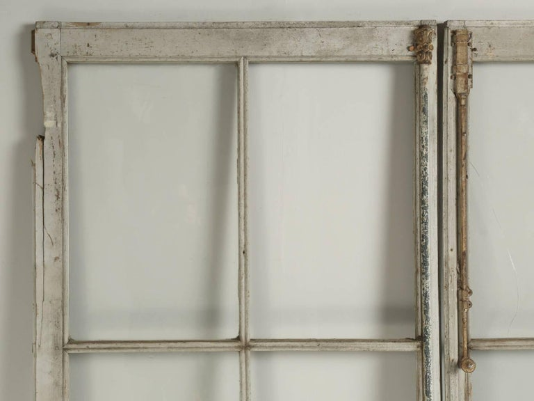 "Wonderful pair of extremely tall at 9' 5"" antique French doors in their original paint. We have not touched the doors, other than to clean the glass and lightly brush off the dust from decades of storage in the south of France. Please note, there"