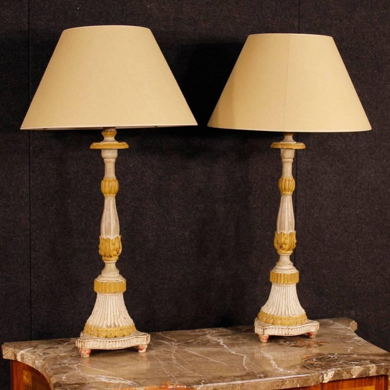 Pair of 19th century French table lamps. Antique carved and lacquered candelabras, electrified during the second half of the 20th century. Modern lampshade in good condition, without tears or stains. Objects of great decor and fabulous furnishings,