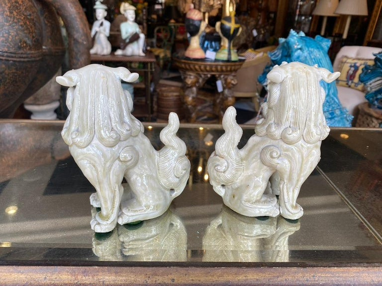 Chinese Export Antique Pair of Shi Shi Foo Dogs For Sale