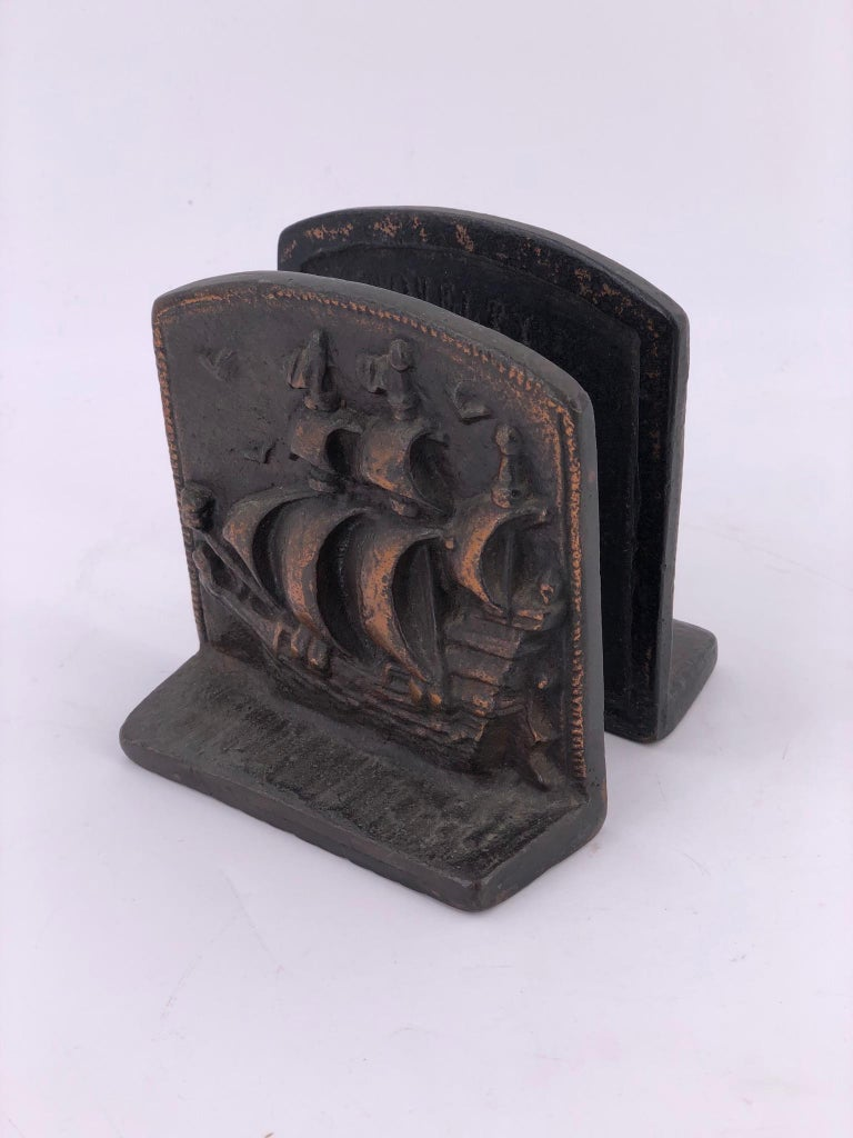 A rare pair of solid bronze bookends with a galley imprint, circa 1940s.