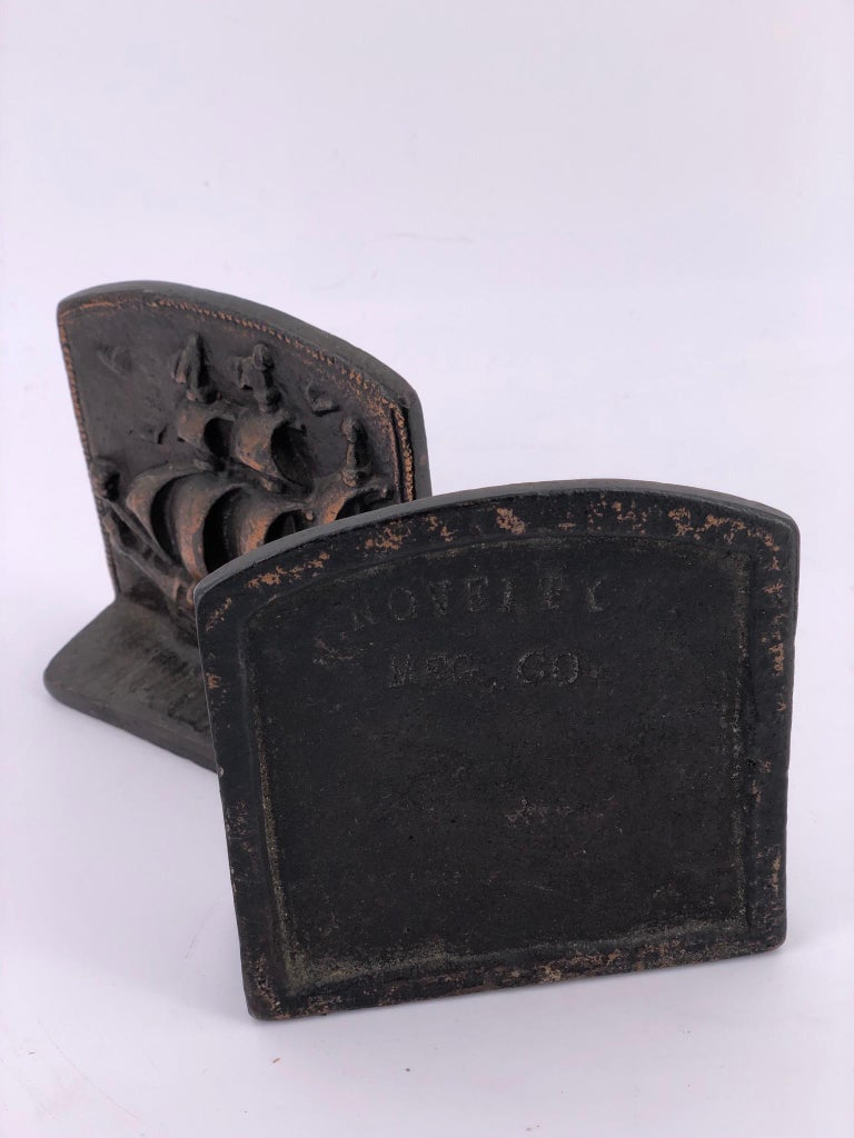 American Antique Pair of Solid Bronze Bookends Galley by Novelty Manufacturing Co. For Sale