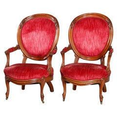 Pair of Victorian Carved Walnut Arm Upholstered Parlor Armchairs, circa 1890