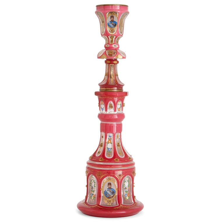 This huqqa (or hookah) is a superb example of the beauty and high quality craftsmanship of Bohemian glassware. The huqqa is decorated with photo-realistic portraits of the Qajar kings, Naser al-Din Shah (reigned 1848-1896) and Mozaffar al-Din Shah