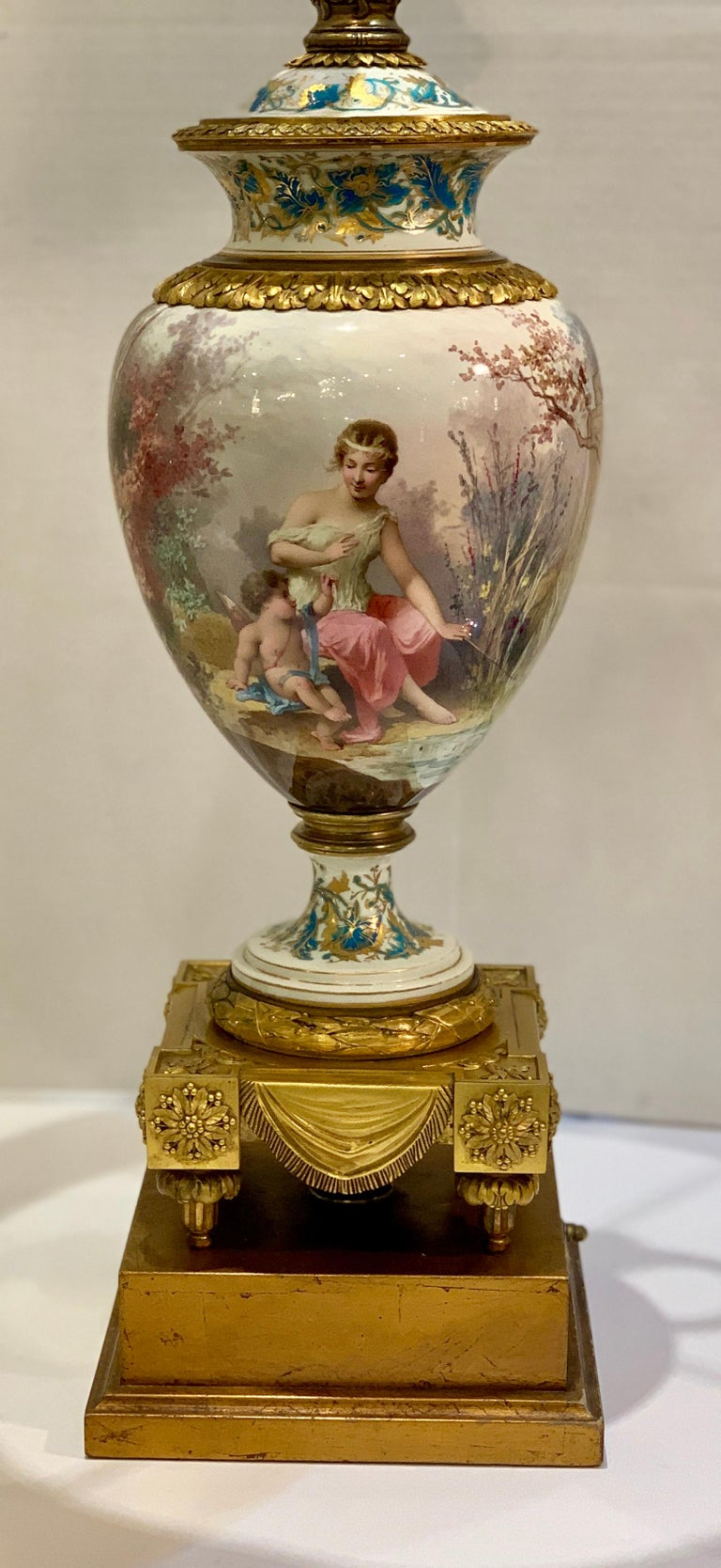 True works of art, these magnificently hand painted, Sevres or psudo-Sevres porcelain lamps from the late 19th century were originally lidded vases. Exquisitely painted in the round and signed by the famous artist Charles Lebarre, and featuring 4