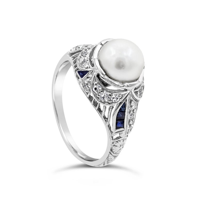 An original antique ring showcasing a 7.15 millimeter pearl, set in an Art Deco style setting encrusted with diamonds and sapphires. Diamonds weigh 0.35 carats total; sapphires weigh 0.17 carats total. Setting made in platinum.  Style available in