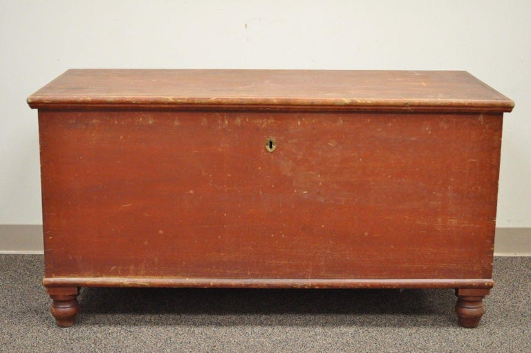 Antique hand dovetailed red painted primitive blanket chest from Pennsylvania. Item features hand dovetailed construction, distressed red paint, bun feet, authentic antique chest, circa late 19th century, PA. Measurements: 25.5
