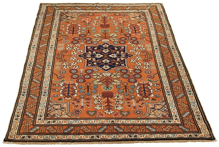Antique Russian area rug handmade from the highest quality of sheep wool. It's colored with eco-friendly vegetable dyes that are safe for humans and pets alike. It's a traditional Darband design handwoven by expert artisans. It's a lovely area rug