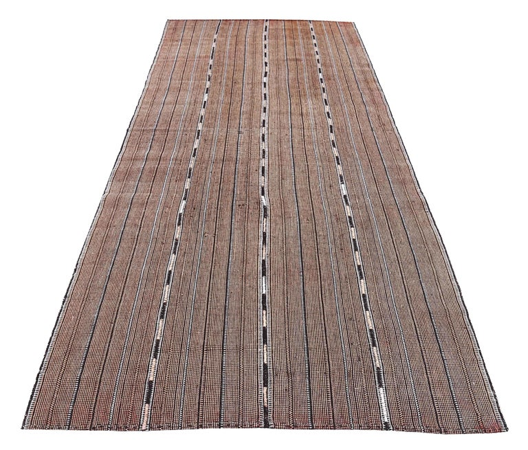Antique Persian area rug handwoven from the finest sheep's wool. It's colored with all-natural vegetable dyes that are safe for humans and pets. It's a traditional Jajm design handwoven by expert artisans. It's a lovely area rug that can be