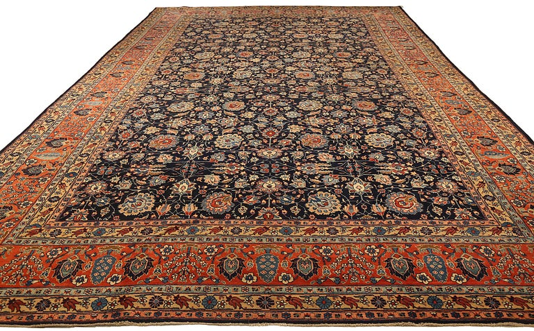 Antique Persian area rug handwoven from the finest sheep's wool. It's colored with all-natural vegetable dyes that are safe for humans and pets. It's a traditional Khoy design handwoven by expert artisans. It's a lovely area rug that can be