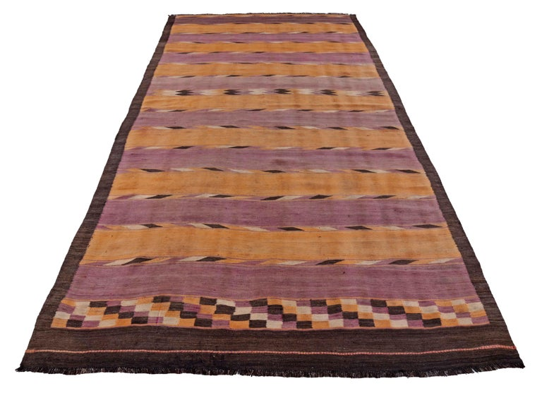 Antique Persian area rug handwoven from the finest sheep's wool. It's colored with all-natural vegetable dyes that are safe for humans and pets. It's a traditional Kilim design handwoven by expert artisans. It's a lovely area rug that can be