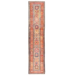 Antique Persian Azerbaijan Runner with Star Medallions in Red, Blue, and Yellow