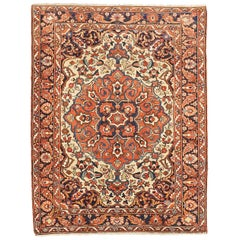 Antique Persian Bakhtiar Rug with Brown & Navy Floral Medallion at Center Field