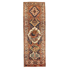 Antique Persian Bakhtiar Rug with Floral Portrait Details on Black & Ivory Field