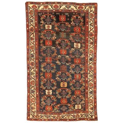 Antique Persian Bakhtiar Rug with Green and Red Flower Details on Black Field