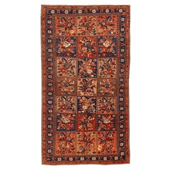 Antique Persian Bakhtiar Rug with Navy and Red Flower Details on Beige Field