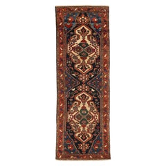 1950s Antique Persian Bakhtiar Runner Rug with Ivory & Red Geometric Medallions