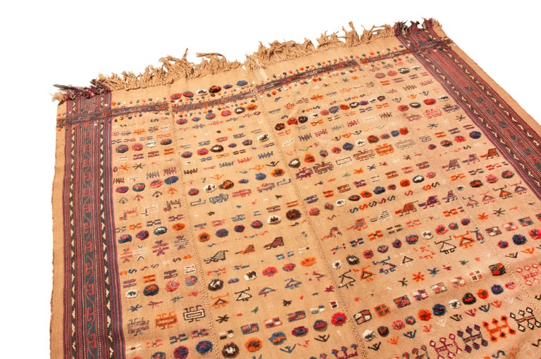 Originating from Persia in 1920, this antique Persian wool kilim. Recognizable by the vertical lines in its borders leading up to its fringes, intact Jajim pieces like this are in swift decline, particularly with this uncommon multi-color field