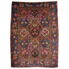 Antique Persian Bibibaf Bakhtiari Carpet in Blue, Pink, Green, Gold Wool