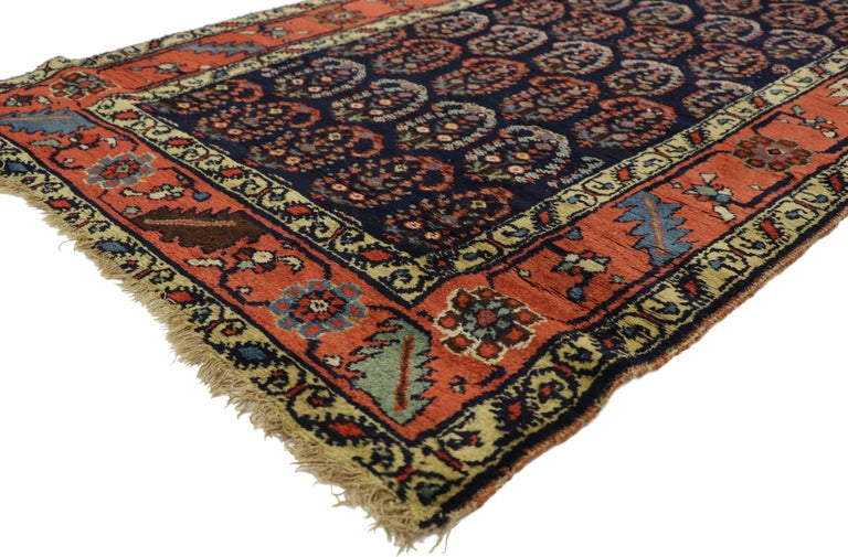 76944 Antique Persian Bijar Runner with Boteh Design and Modern Victorian Style. This hand-knotted wool antique Persian Bijar runner displays an all-over repetitive pattern of opulent boteh motifs. The widely used boteh motif is thought to symbolize