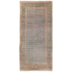 Antique Persian Farahan Rug with All-Over Repeating Design and Opulent Borders