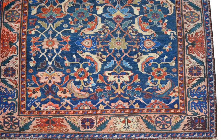 """This antique Persian Farahan Sarasar carpet circa 1880 in pure handspun wool and organic vegetable dyes is hand knotted in a Persian Farahan weave, and the overall or """"Sarasar"""" design is characterized by geometric flowers in red and blue tones."""