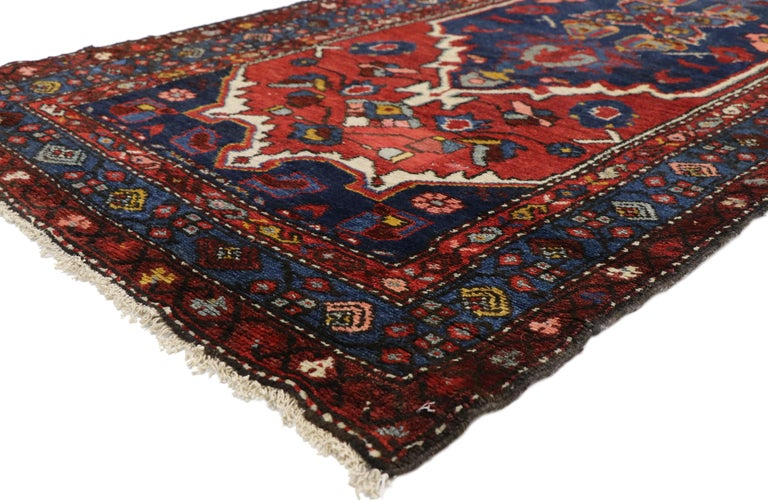 72851, antique Persian Hamadan extra-long hallway runner with English Manor Tudor style. Dignified with bespoke style, this antique Persian Hamadan runner features a pair of large-scale navy blue cartouche medallions outlined in ivory and surrounded