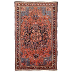 Antique Persian Hamadan Rug with Blue and Red Flower Details on Black Field