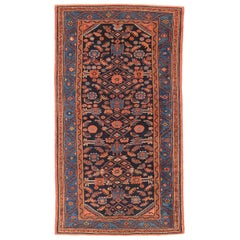Antique Persian Hamadan Rug with Navy and Red Floral Details on Black Field