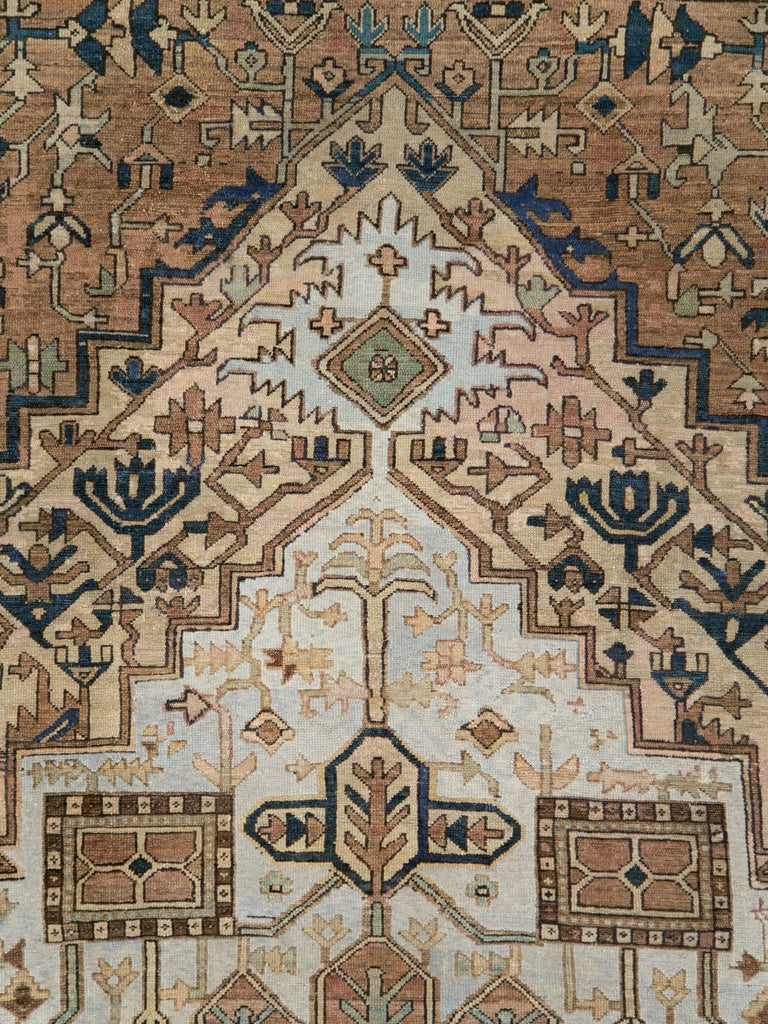 An antique Persian Heriz carpet from the early 20th century.