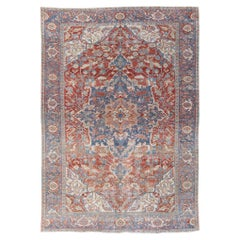 Antique Persian Heriz Handmade Red and Blue Medallion Floral Wool Rug
