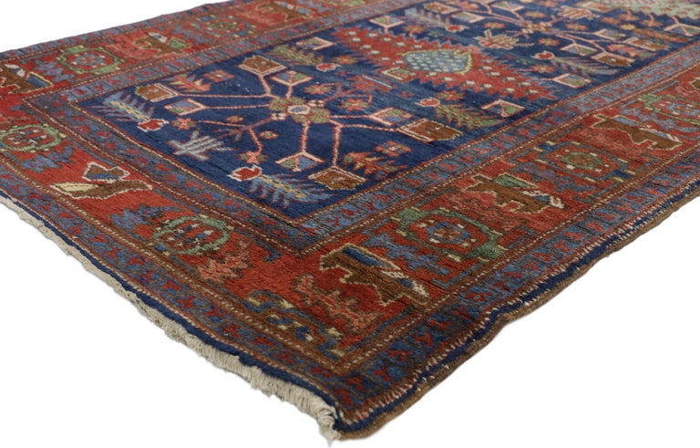 77053, antique Persian Heriz Karaja runner with Art Deco Tribal style, extra long hallway runner. This hand knotted wool antique Persian Karaja Heriz runner features a column of distinctive medallions and amulets similar to those found in Caucasian