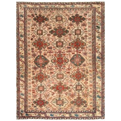 Antique Persian Heriz Handmade Wool Rug in Red, Blue, Green, Pink and Beige