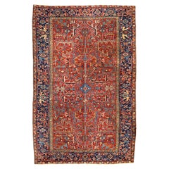 Antique Persian Heriz Rug, All-Over Red Field Navy Border, circa 1930s