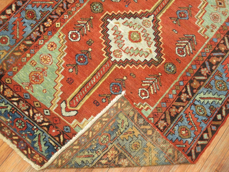 An antique Persian Heriz one of a kind Square Scatter rug.