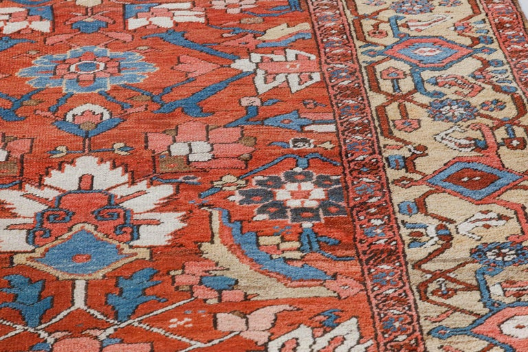 Hand-Knotted Antique Persian Heriz Rug in Blue, Pink, Red, White, and Yellow For Sale