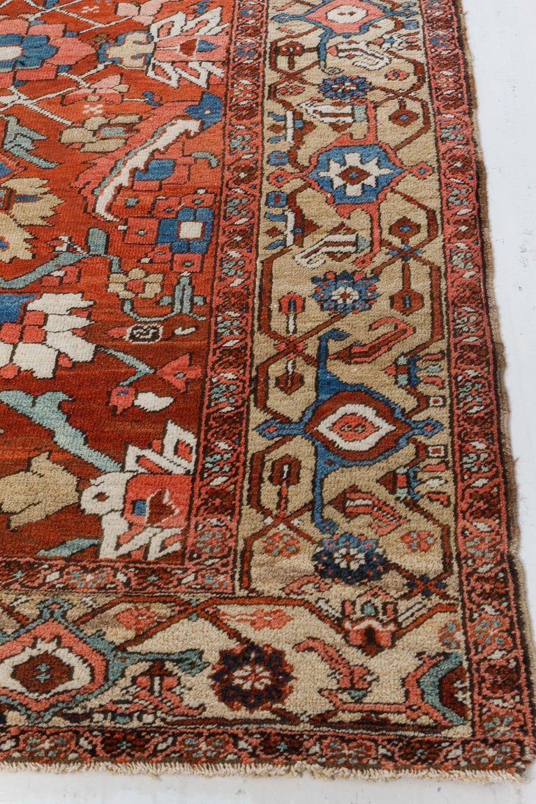 20th Century Antique Persian Heriz Rug in Blue, Pink, Red, White, and Yellow For Sale