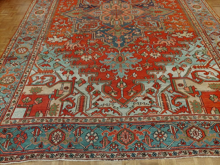 Great looking Persian antique Heriz with perfect harmony of design and colors rust field with glorious light blue spandrels and a light border with Classic geometric motif, circa 1910. Room size, size: 9 x 12-10.