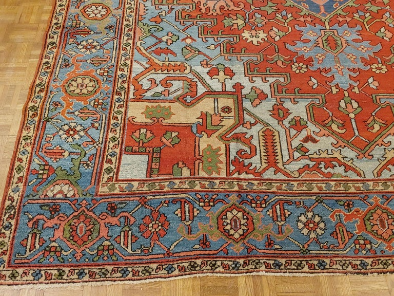 Woven Antique Persian Heriz Rug, Rust Colored with Light Blue Wool, Room Size For Sale