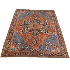 Antique Persian Heriz Rug, Rust with Blue and Teal Corners, Wool, 1915