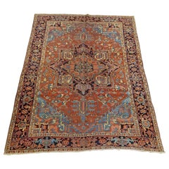 Antique Persian Heriz Rug, Rust With Light Blue Corners, Wool, 1915