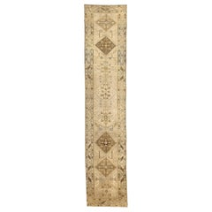 Antique Persian Heriz Runner Rug with Brown Tribal Motifs on Ivory Field