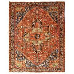 Antique Persian Heriz-Serapi rug with a Bold Geometric Design