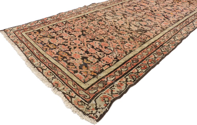 75342, antique Persian Hussainabad Hamadan runner, hallway runner. This hand knotted wool antique Persian Hussainabad Hamadan runner features a lively all-over Herati pattern that densely fills the field. A series of floral vine, boteh, and a