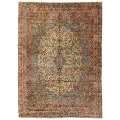 Antique Persian Ivory and Blue Floral Kirman Rug, circa 1920s